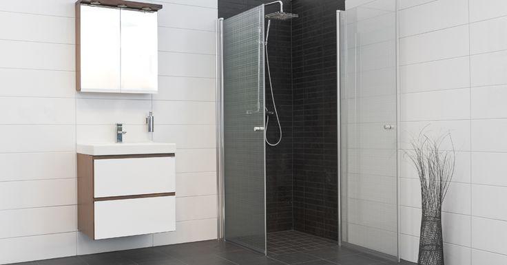 Annan färg på kaklet i duschen (små rutor).  Vita breda kakelplattor på väggen.  Mörkgrått kakel (stora rutor) på golvet.    Vit - Vägg: 20x60