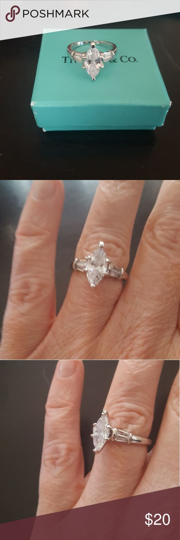 Engagement Marquis 'Diamond' style ring Beautiful engagement style ring. Marques shaped stone with baguette sides. NOT 925. Jewelry Rings