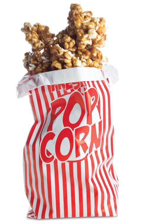 Classic Caramel Corn - Crunchy, sweet homemade caramel corn can be made even better with the addition of nuts or chocolate chips.
