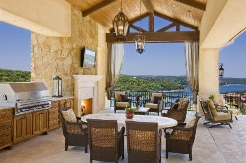 . It's hard to say what's more striking about this beautiful patio — the view or the stunning construction of the patio itself
