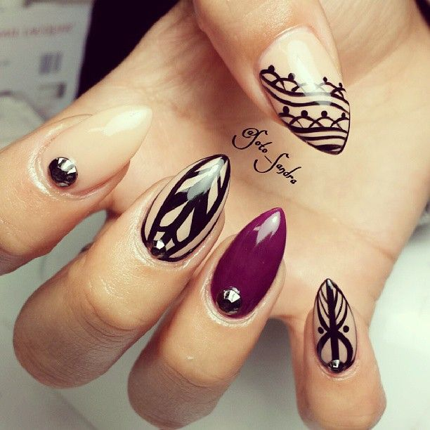 Soti_sandra stunning nude and black patterned stiletto nails with a burgundy standout nail - we think these are lovely...x