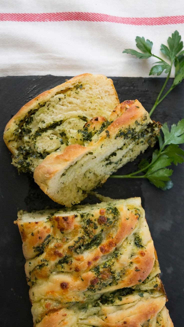 Recipe with video instructions: Jen makes garlic bread classy AF. Ingredients: For the dough:, 2 ½ cups all-purpose flour, 2 ¼ tsp active dry yeast (one packet), 1 ¼ cup warm milk, ½ tsp sugar, 1 tsp salt , For the filling:, 1 head of garlic, peeled and minced, 4 tbsp fresh parsley, finely chopped, ⅓ cup parmesan, grated, ½ cup butter, softened, ½ cup mozzarella, shredded