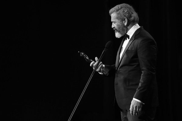 Mel Gibson Photos Photos - (EXCLUSIVE COVERAGE) (EDITORS NOTE - IMAGE HAS BEEN CONVERTED TO BLACK & WHITE) Mel Gibson speaks after winning the AACTA Award for Best Film presented by Foxtel for Hacksaw Ridge during the 6th AACTA Awards Presented by Foxtel at The Star on December 7, 2016 in Sydney, Australia. - 6th AACTA Awards Presented by Foxtel | Backstage
