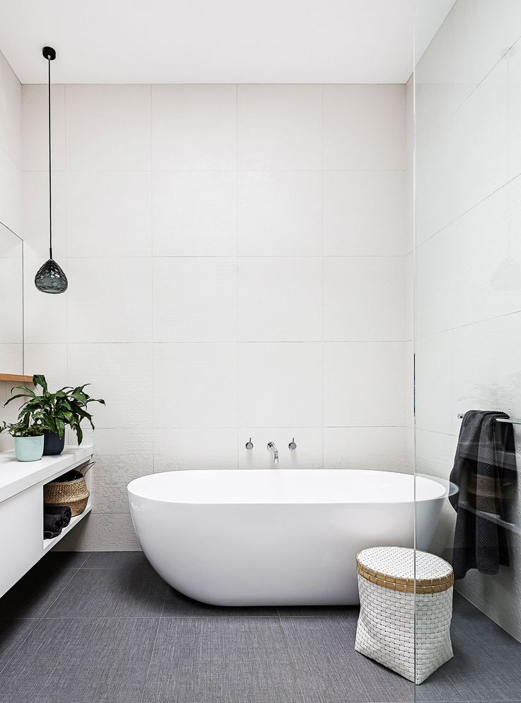 "The spacious bathroom has a large bath from [Bathroom Warehouse](https://bathroomwarehouse.com.au/|target=""_blank""). Linen-look floor tiles give a luxe finish."