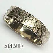trouwringen van arnaud volgens uw of mijn ontwerp uitgevoerd in zilver goud platina en titanium en graveert met de hand uw namen en huwelijksdatum