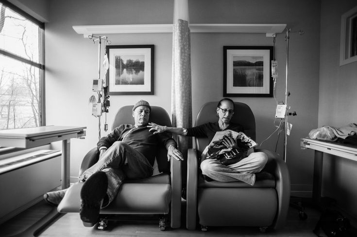 "Howie sits beside his wife Laurel in what he calls their ""his and hers"" chairs as they get their weekly chemotherapy treatments."