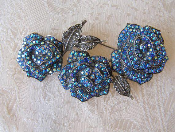 Blue roses broochaurora borealis blue crystal brooch by Mpoulitsa