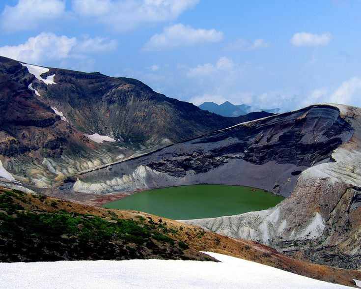Crater Lake (Okama), Mt. Zao – Honshu, Japan.  Mount Zao is a complex volcano on the border between Yamagata Prefecture and Miyagi Prefecture in Japan. With a height of 1841 m, Mount Zao is one of the most prominent mountains in the Tohoku Region. The active volcano feature a beautiful creter with lake, known as Okama due to its resemblance with a traditional cooking pot.