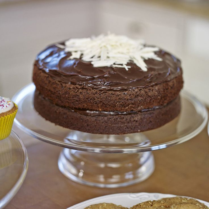 Mary Berry's Very Best Chocolate Cake (apricot jam spread over the top of each layer before adding the ganache)
