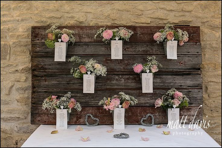 Fresh flowers used on a wedding table plan at Kingscote Barn