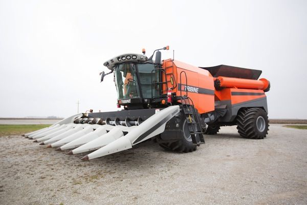 "Tribine – agriculture's latest breakthrough innovation. The giant harvesting machines on farms have been called ""combines"" because they combined - reaping, threshing, and winnowing - into a single process. The Tribine also integrates a 1,000-bushel grain cart into the mix."
