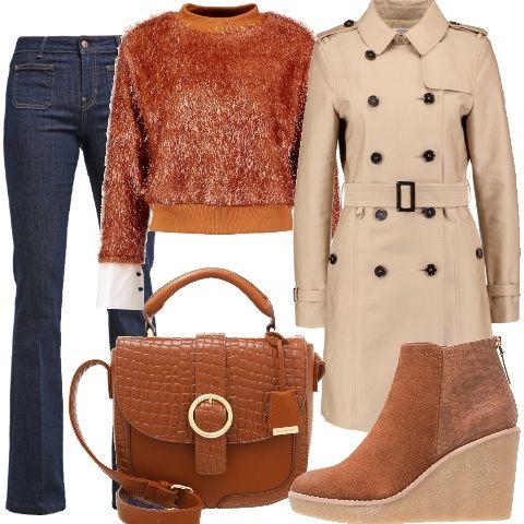 Un jeans e una maglietta, recitava una canzone degli anni 80 ma, visto la stagione meglio con un maglione come questo proposto in color cognac, modello corto con ampi polsini in tessuto, e un jeans trendy, proposto nel modello a zampa, vita alta e tasche esterne. Capospalla un trench, beige con colletto classico e bottoni. Ritornano le zeppe, ancora, per gli stivaletti in finta pelle animalier e tessuto scamosciato abbinati alla borsa rigida a tracolla con chiusura magnetica.
