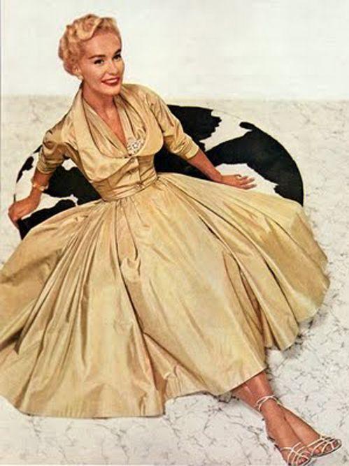 Model wearing a yellow silk cocktail dress, 1952