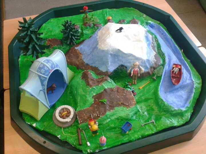 Small world camping area made from papier mache to fit our builders tray.