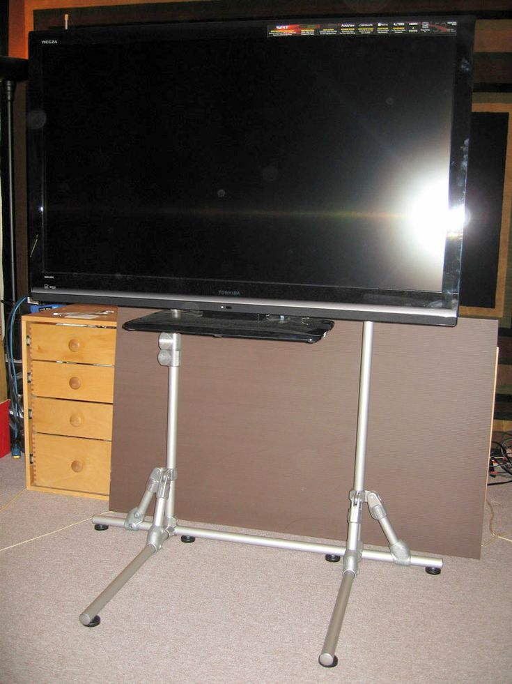 This person decided that they would make their own custom flat screen TV stand with Kee Lite aluminum fittings and aluminum pipe. Their TV stand was designed to sit behind a desk. The upirght...