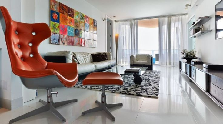 Sleek and modern living room area with neat granite floor