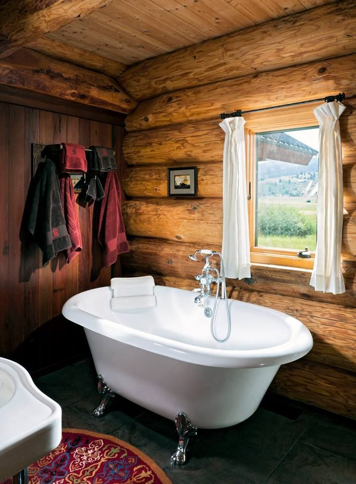 Western Rustic Cabin Bathroom. Such a beautiful tub and view!