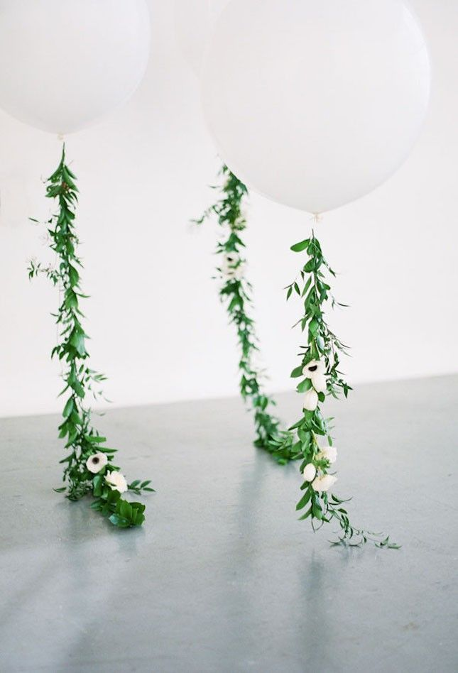 Giant white helium balloons with floral garland strings will make a fantastic statement at your wedding