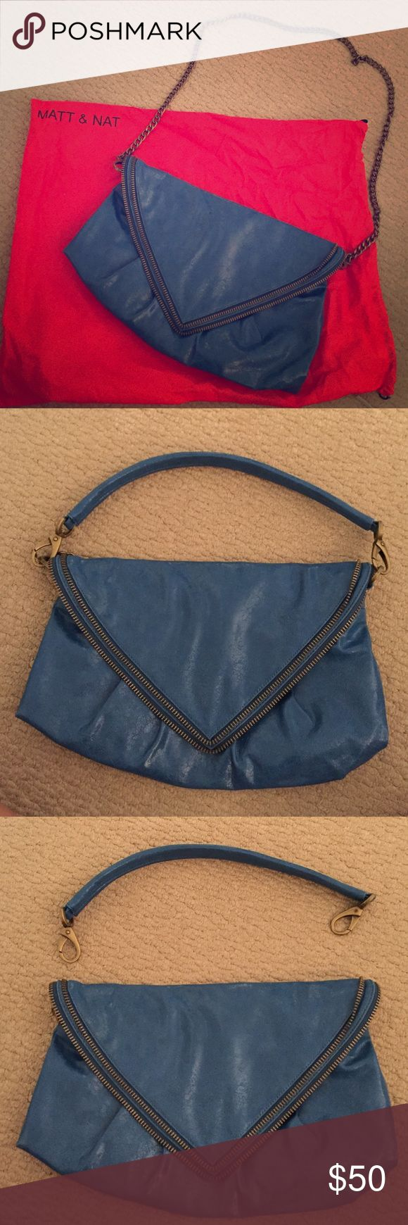 Matt and Nat handbag/crossbody/clutch! A 3 in one Matt and Nat bag. Can either be a handbag, a crossbody or a clutch! Includes interchangeable straps for whatever type of bag you need that day! Beautiful zipper design on the front. Includes dust bag. In excellent condition Matt and Nat Bags Shoulder Bags