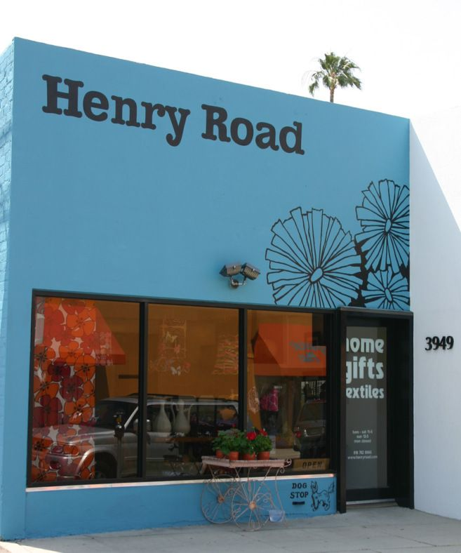 Henry Road Store in LA | decor8  black graphics, external powder blue wall
