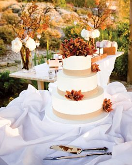 The buttercream-frosted cake was decorated with fresh cymbidium orchids. Each tier featured a different flavor of cake: double chocolate; ivory apricot; and vanilla bean pound cake. In addition to the cake, guests were offered Italian cookies. Kim and Niki, Photographers.