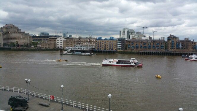 Boats along the river Thames, seen from the southside of the Thames. London