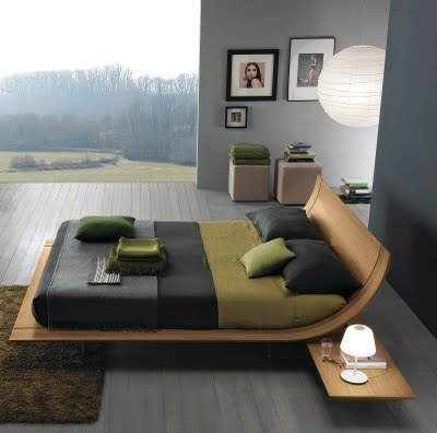 Modern sleigh bed  image: ddc (domus design collection), New York