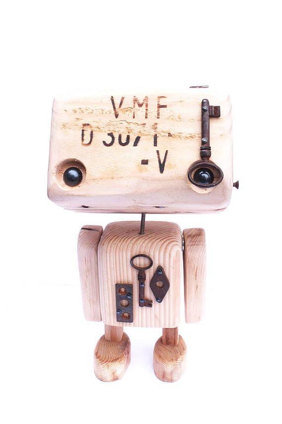 Robot / gerealiseerde decoratieve beeldje (e) gerecycled hout.  Er zijn verschillende, elk uniek en heeft zijn eigen kenmerken. Metalen onderdelen worden toegevoegd in sommige plaatsen, die geeft een identiteit aan de robot.  Afmetingen: Hoogte (ongeveer) 27,5 cm x breedte 18 cm  (Goedkoper) levering door global relay is mogelijk op aanvraag. Contacteer ons per e-mail alvorens uw bestelling te plaatsen.    Collectieve 56 p - wie wij zijn?  Ons idee is om materialen als schroot, een nieuw...