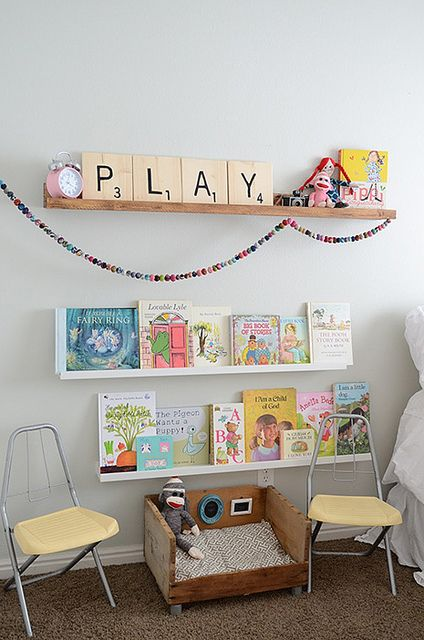 Love this little play area for the kids in the living room. When you have kids, your design basically becomes about them and how it can function well. But it doesn't hurt to have it look cute, too!