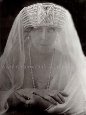 Marie of Romania again.  She has the biggest tiaras ever...