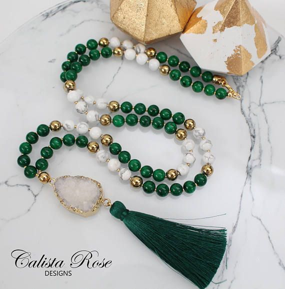 An elegant tassel necklace made with a raw quartz druzy pendant, deep emerald Jade, gold Hematite and white howlite. Style it with a white blouse or dress and the green really pops! Necklace measures about 33-34 inches all around with a drop length of 22 inches (from clasp to