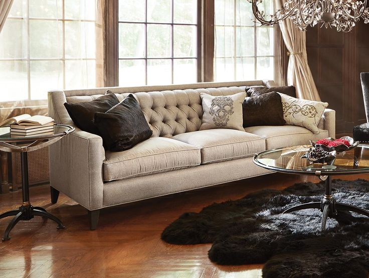 Bring the glitz of old hollywood to your home with the arhaus rylan tufted upholstered sofa in shimmering taranto dove