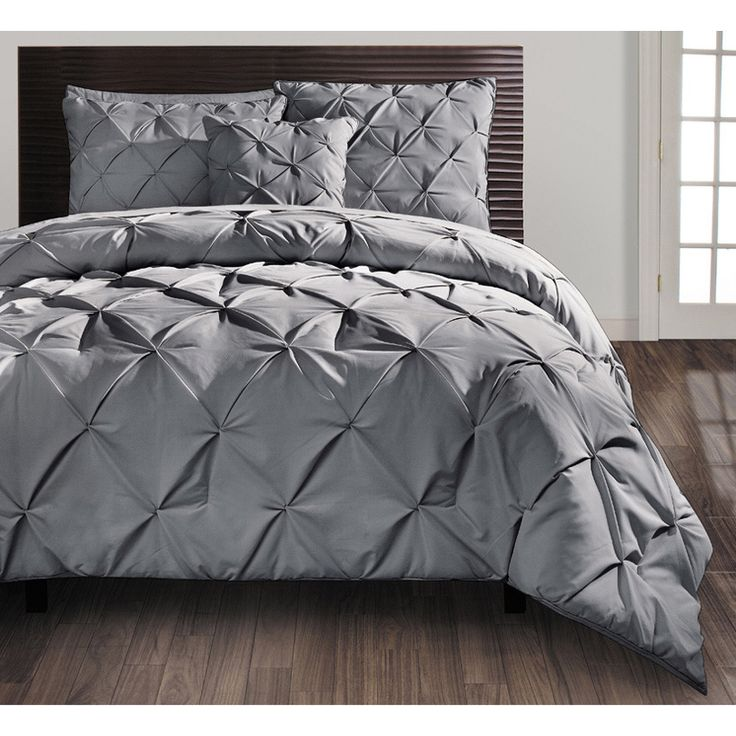 A puckered diamond design embellishes this contemporary set for your king or queen-size bed. Available in grey, white, and taupe, this set will easily match your current decor. Beautify your bedroom with this sophisticated four-piece comforter set.