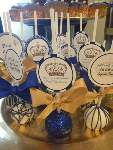 blue and gold cake pops at a royal prince baby shower party see more