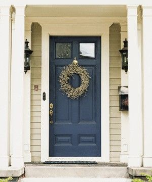 CURB APPEAL – another great example of beautiful design. Navy Door against what appears to be a Green Paint.