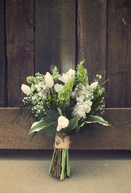 A classic white-and-green bouquet comprised of tulips, lilies, and greenery, created by Thrifty Florist.