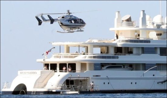 Eurocopter EC-135T1 and a Yacht owned by Roman Abramovich