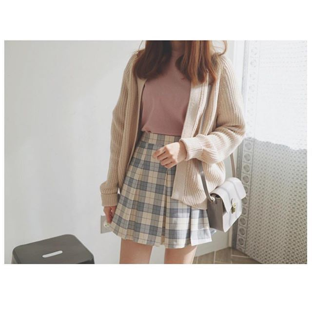 I love the mix of pastel colours, and the cut of the skirt is adorable.