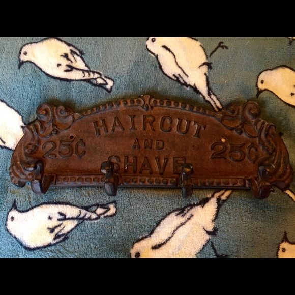 Decorative cast iron wall plaque with 4 hooks. Vintage look Haircut & Shave 25c plaque with 4 hooks. Very high quality piece, heavy. Great for a bachelor pad, teen boys room or barbershop! 2 are available. Other