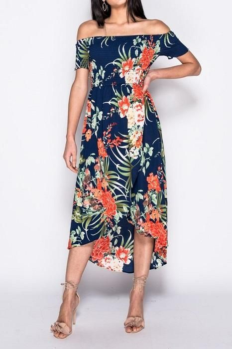 8dfa9e1993091 This lively, navy, off the shoulder style dress, features tropical print,  shirring