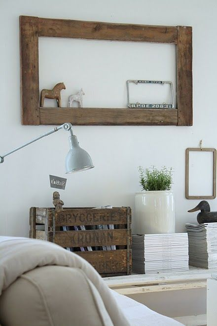 Niiice ideas of the empty frame, wooden box, flower pot on a pile of magazines. I'll copy these ideas ;)