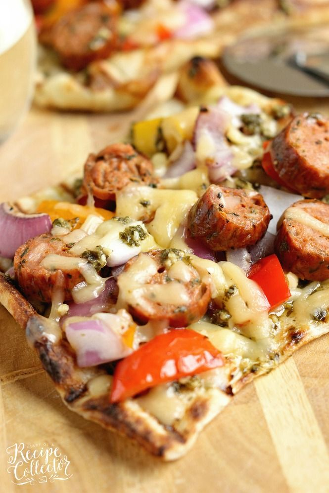 Grilled Sausage & Pepper Pizza - Grill your pizza and top it with delicious Italian Style Smoked & Chicken Sausage, peppers, onions, basil pesto, and Fontina cheese.