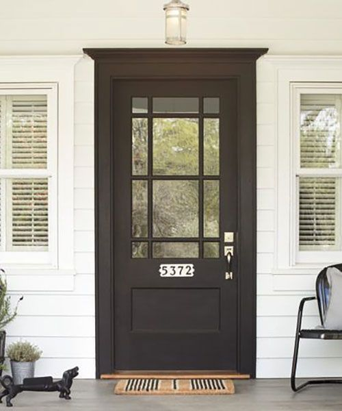 Make bright-white porcelain-tile house numbers, (about $75; @rejuvenationinc), pop for mail carriers and visitors alike with a stark, sophisticated black-painted front door.