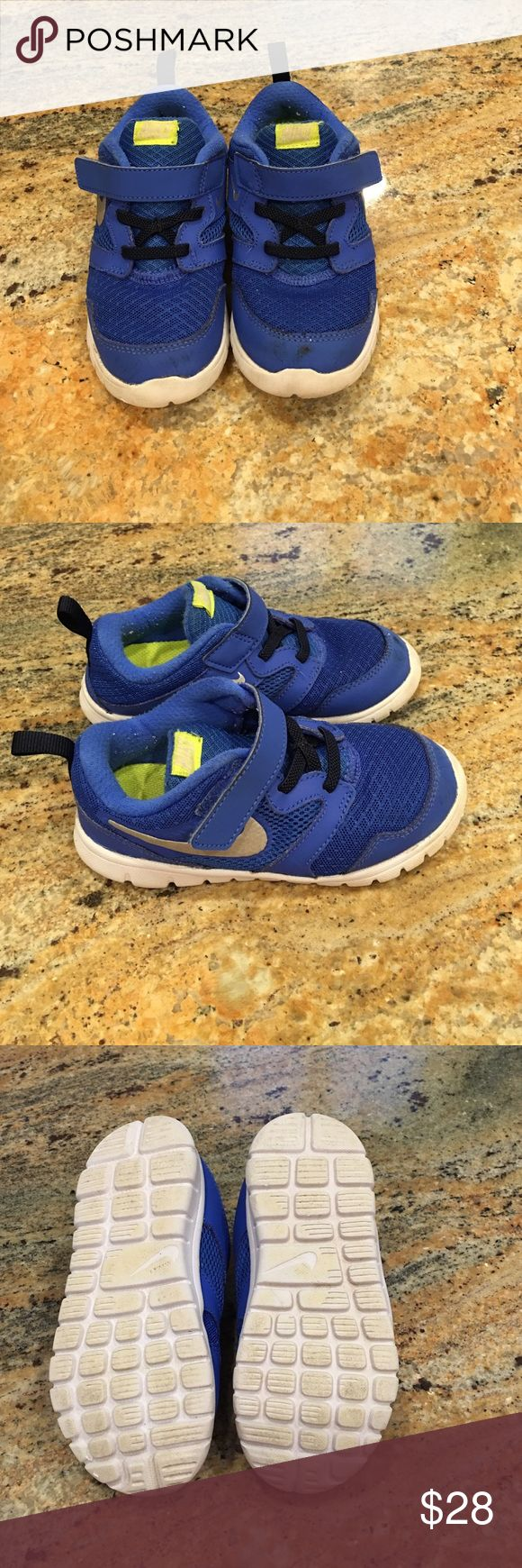 Toddler boys Nike shoes The toddler boys Nike shoes are a size 10. They are neon yellow and blue. Nike Shoes Sneakers