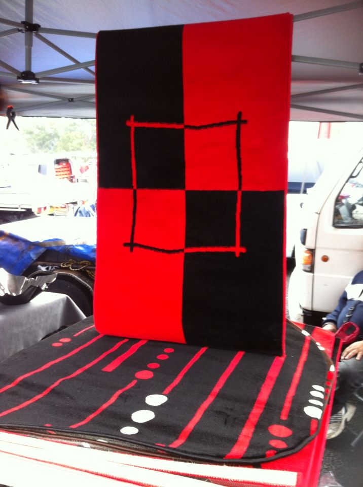 Red black rug found at Blacktown drive in markets.