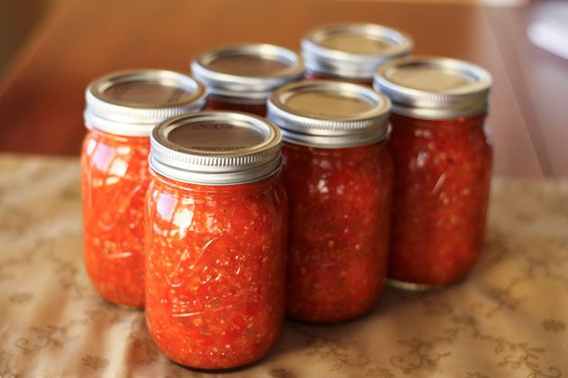 """Adjika. (Russian). A sauce that's described as a """"Russian Pesto"""" and goes good with pasta.  Seems very healthy -- uses apples, carrots, bell peppers, garlic, tomatoes, jalapeno peppers and olive oil... sounds quite yummy! Can be stored in jars like above! :)"""