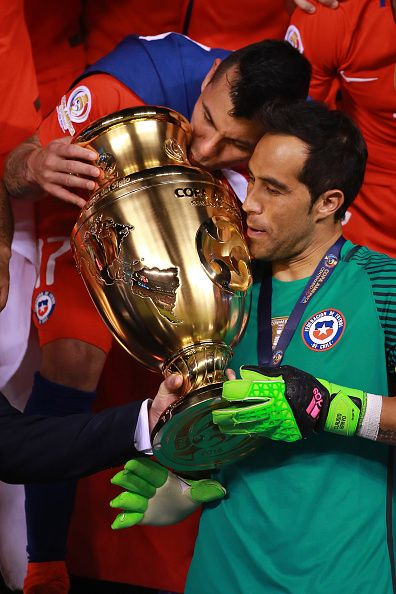#COPA2016 #COPA100 Gary Medel and Claudio Bravo of Chile celebrate with the trophy after winning the championship match between Argentina and Chile at MetLife Stadium...