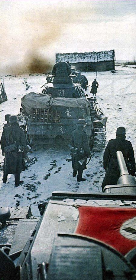 Panzerkampfwagen III Ausf. G advancing with Wehrmacht Infantry during the Unternehmen Taifun, Winter Krieg im Ostfront, 1941-42.