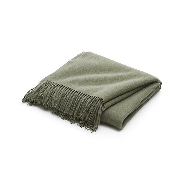 Shop Lima Alpaca Sage Green Throw.  Indulge in the warmth and luxury of premium alpaca wool, known for being softer and warmer than the finest lambswool.  The fiber also absorbs the soft green color beautifully and is less likely to pill than wool.