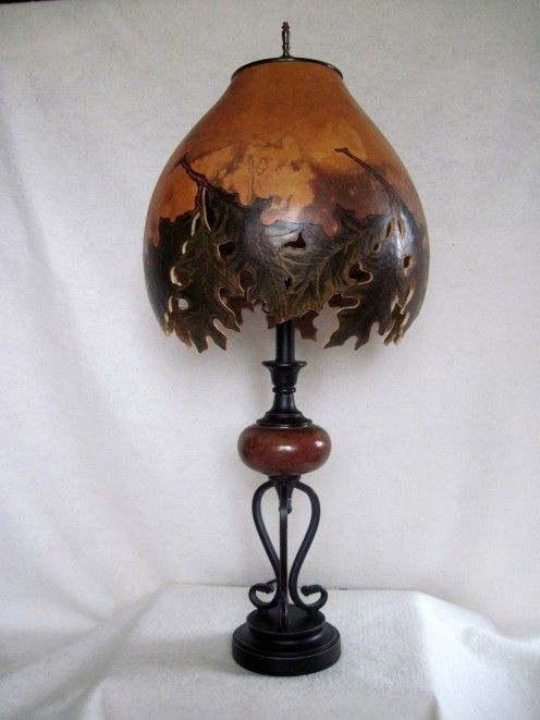 Gourd lamp shade. I wonder how long a stained gourd lantern would last outside, hanging from a pergola or tree branch?